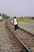 foto of train track  - urban teen walking on the tracks  - JPG