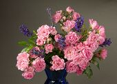 picture of flower arrangement  - A bouquet of Mossroses in a blue vase with lavender - JPG