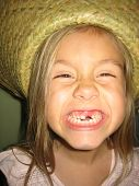 picture of tooth gap  - missing teeth lost tooth tooth smile kid girl smile big smile missing a tooth girl in hat hat big gap gap smile big close up of girl missing tooth - JPG