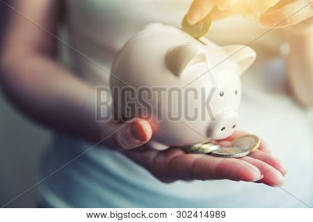 poster of Female Woman Hands Holding Pink Piggy Bank And Putting Money Euro Coin. Saving Investment Budget Bus