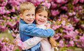 Love Is In The Air. Romantic Babies. Couple Kids Walk Sakura Tree Garden. Tender Love Feelings. Litt poster