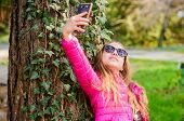 Happy Child In Park. Selfie Time. Natural Beauty. Childhood Happiness. Summer Nature. Little Girl Ma poster
