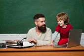 Daddy Play With Schoolboy. Daddy Teacher. Teacher And Schoolboy Using Laptop In Class. Man Teaches C poster