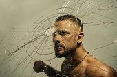 Determination To Succeed. Muscular Man Having Inner Determination And Commitment To Break Glass Wall poster