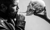 Man Smoking Cigarette Near Human Skull Symbol Of Death. Harmful Habits. Destroy Your Health. Smoking poster
