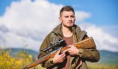 Hunting Equipment And Safety Measures. Man With Rifle Hunting Equipment Nature Background. Make Sure poster