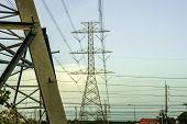 Electricity Pole Against Blue Sky Clouds In Dawn Time, Transmission Line Of Electricity To Rural, El poster