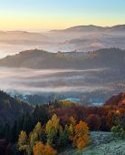 Majestic Autumn Rural Landscape. Interesting Sunrise. A View From The Lawn To The High Mountains And poster