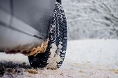 Wheel With Spikes On A Winter Road. Winter Road. Snow Road. Car On The Winter Road. Footprints In Th poster