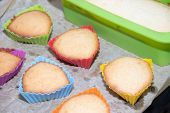 Silicone Homemade Muffins On Parchment. Homemade Baking. Sponge Cake poster