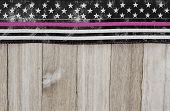 American Thin Pink Line Flag Over Weathered Wood Background With Copy Space For Your Message poster