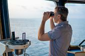 Navigational Officer Lookout On Navigation Watch With Binoculars poster