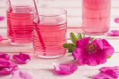 Homemade rose petal syrup, made with fresh organic roses.  poster