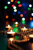 Fire Of Candle On Christmas Background. Christmas Candles Burning At Night. Abstract Candles Backgro poster