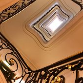 View Bottom Up On Beautiful Luxury Staircase With Wooden Railings. Photo Consists Of Staircase With  poster