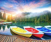 Boats On Majestic Mountain Lake Lacul Rosu Or Red Lake Or Killer Lake. Splendid Foggy Summer Scene O poster