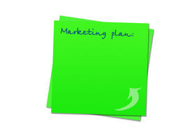 stock photo of marketing plan  - green sticky note marketing plan white background - JPG