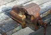 foto of blacksmith shop  - old rust-covered grip used by blacksmiths to once