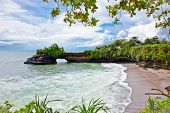 Beautiful beach and Pura Batu Bolong temple on Bali, Indonesia.