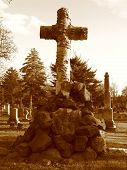 pic of embalming  - Cross on top of gravestone in the Greenwood Cemetery in Brooklyn  - JPG