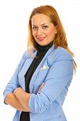 pic of semi-formal  - Happy business woman standing with arms folded in semi profile isolated on white background - JPG