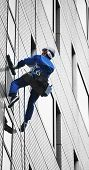 stock photo of high-rise  - High rise window cleaner on the job taken in Japan - JPG
