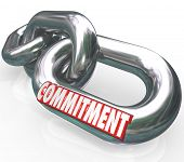 stock photo of trustworthiness  - The word Commitment on chain links locked together to illustrate dedication - JPG