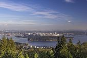 stock photo of inlet  - Vancouver BC Canada Cityscape with Stanley Park and Lions Gate Bridge Over Burrard Inlet - JPG