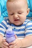 Baby With Milk Bottle Unhappy
