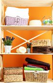 picture of armoire  - Beautiful white shelves with different home related objects - JPG