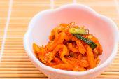 image of kimchi  - Korean Kimchi in a bowl on bamboo mat - JPG