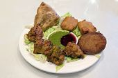 image of samosa  - East Indian Food Appetizer Starter Dish with Samosa Pakoras Vegetable Cutlets with Chutney Tamarind Dipping Sauce