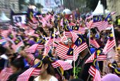 People Waving Malaysian Flags