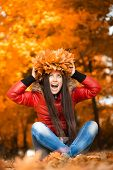 pretty woman in a wreath of autumn leaves