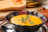 stock photo of vegetarian meal  - Hot delicious pumpkin soup in a bowl - JPG