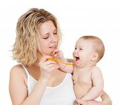 image of love bite  - cute baby eating with help of spoon - JPG