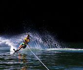 picture of ski boat  - a young woman water skiing on a lake - JPG