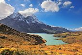 Chilean Patagonia. Snow-capped mountain peaks and fabulous lake with emerald water