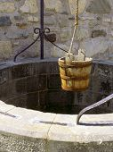 stock photo of wishing-well  - A water well with an old bucket in Fort Louisburg - JPG