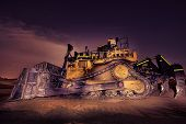 picture of iron star  - A Big yellow bulldozer late at night - JPG