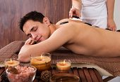 Man Receiving Lastone Therapy In Spa poster