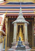picture of hermit  - Bronze statue of a seated hermit behind the ubosoth of the Emerald Buddha at Wat Phra Kaew in the Grand Palace complex in Bangkok Thailand - JPG