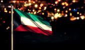 foto of kuwait  - Kuwait National Flag City Light Night Bokeh Background 3D - JPG