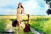 foto of hippy  - Romantic girl travelling with her guitar - JPG