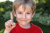 picture of bandage  - Smiling boy with a bandaged finger - JPG