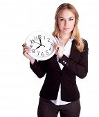 picture of punctuality  - Portrait of beautiful young business woman holding in hands clock - JPG