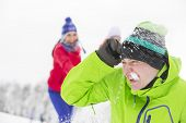 stock photo of snowball-fight  - Young friends having snowball fight - JPG