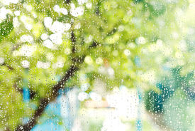stock photo of rainy season  - wet home window with raindrops after summer rain - JPG