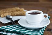 stock photo of churros  - churros con chocolate a typical Spanish sweet snack on old wooden table - JPG