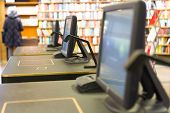 picture of borrower  - desk for borrowing or returning books in public library - JPG
